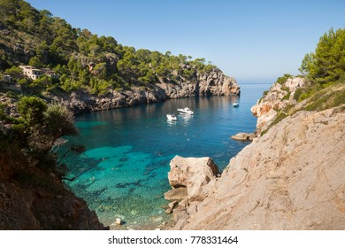 High viewpoint of idyllic Cala de Deia inlet in Majorca, Spain