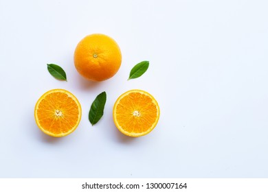 High vitamin C. Fresh orange citrus fruit with leaves isolated on white background. Copy space