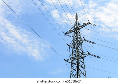 High volt Mast for electricity in blue cloudy sky