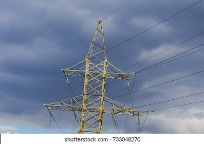 high voltage electric pillar against the sky, wires and insulators