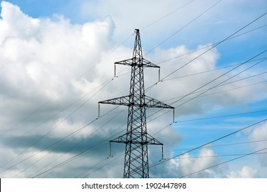 High voltage electric pole close-up. Power line in the countryside. Electric station supplying electricity to the city.