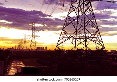 High voltage electric pole supply electricity to the city with the twilight sky on background.