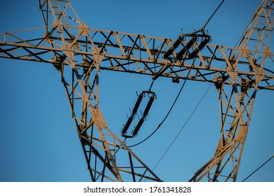 High voltage electric poles with ceramic insulators