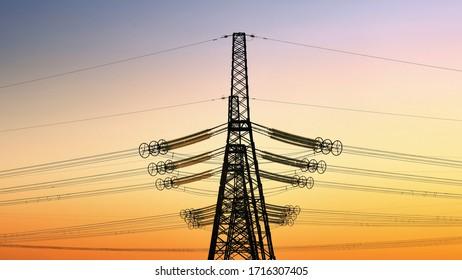 Tour électrique haute tension au coucher du soleil. arrière-plan ciel tourné. Power Tower