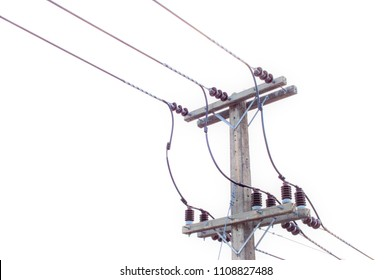 High voltage electric transmission pylon silhouetted tower on white background