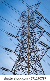 High Voltage Electrical Pole Structure with beautiful blue sky background.