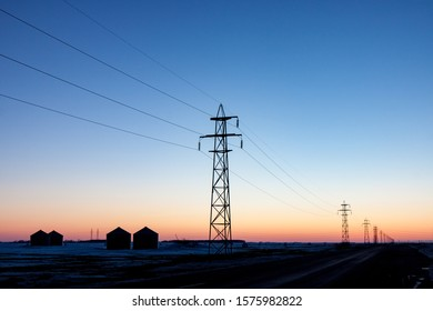 High Voltage Electrical Transmission Towers at Sunset