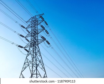 High voltage electricitiy tower with string cable over the blue sky