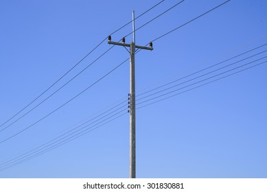 High voltage electricity pole with blue clear sky background