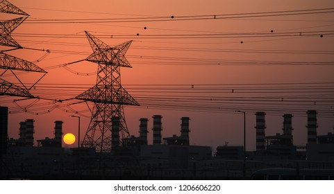 high voltage electricity pole at sunset. energy concept, industrial photo