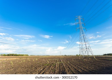 High voltage electricity poles, in the field, Thailand.