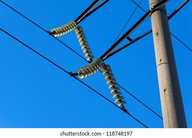 High voltage electricity pylon over blue sky