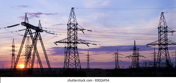 High voltage electricity pylon over sunset