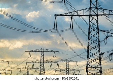 High voltage electricity pylons at sunset.