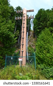 high voltage electricity tower or pylon a steel lattice tower support overhead power line. Electricity transmission in mountain regions through complicated geographic conditions