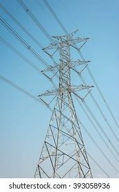 High voltage electricity transmission pylon  against blue sky