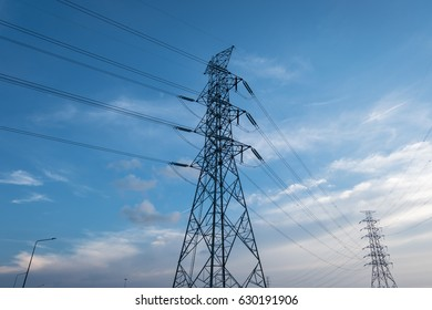 high voltage electricity transmission tower with sky background