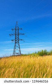 High voltage lines against a background of blue sky