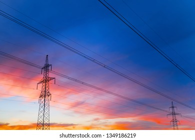 High voltage lines against the dramatic sky