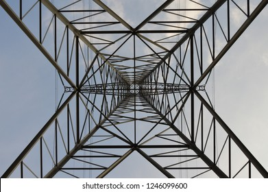 A high voltage mast photographed from below.