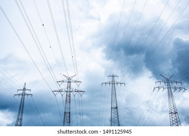 High voltage masts with dramatic clouds