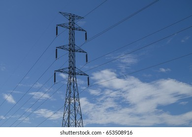 high voltage pillar on blue sky background