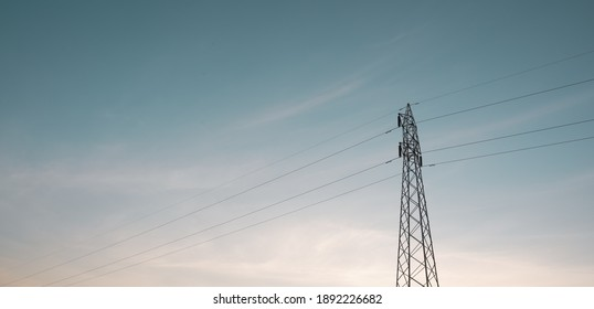 High voltage pole with a beautiful sky
