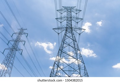 High voltage pole with clouds and skies background