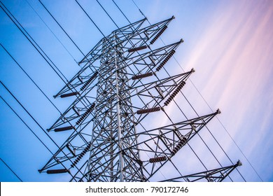 High voltage pole with color of sunrise sky, electricity post