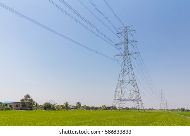 High voltage pole in the field.