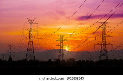 High voltage pole on silhouette sunset background