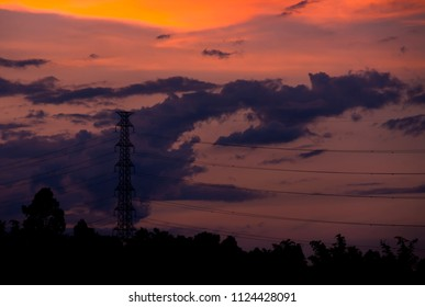 High voltage pole in sunset background
