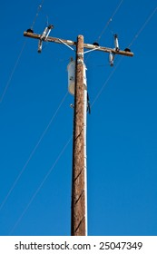High Voltage Post against Blue Sky