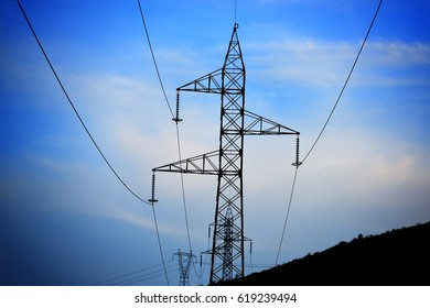 High voltage post. High-voltage tower, sky background.