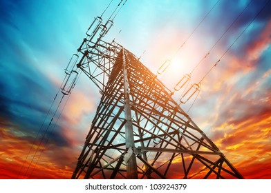 high voltage post at sunset