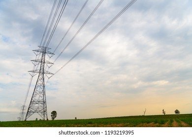High voltage post, High voltage tower, Electricity transmission power lines on cloudy sky background