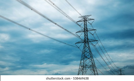 high voltage post.High-voltage tower on sky background