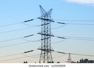 high voltage post.High-voltage tower sky background