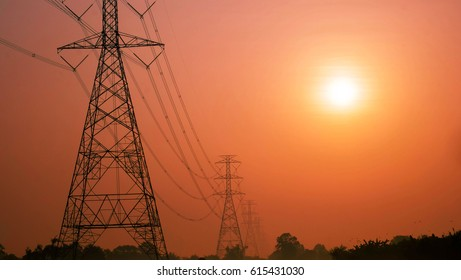 high voltage post.High-voltage tower with sunrise