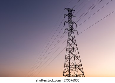 high voltage post.High-voltage tower sunset background.