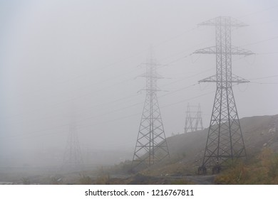 High voltage posts in the fog. Norilsk. August 27, 2018