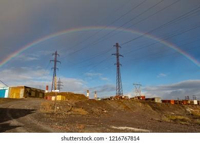 High voltage posts and rainbow. Norilsk. September 05, 2018