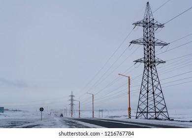 High voltage posts. Springs and snow. Norilsk. April 24, 2018