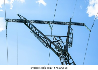 High voltage power line  on a blue sky background. Close-up
