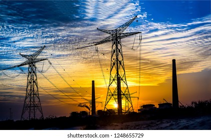 High voltage power line sunset sky clouds. Sunset high voltage power lines view. Sunset high voltage power lines. High voltage power lines sunset scene