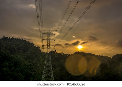 high voltage power line through a valley inside deep jungle