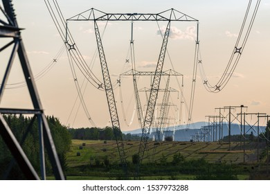 High voltage power lines draped over farm fields