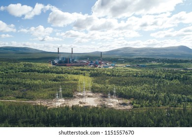 High Voltage Power Lines Electricity Pylons Towers Supplying Aluminum Plant. Aerial View