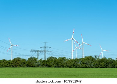 High voltage power lines and wind turbines seen in rural Germany