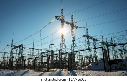 High voltage power lines in the winter. Thermal power plant. High-voltage transformer substation.